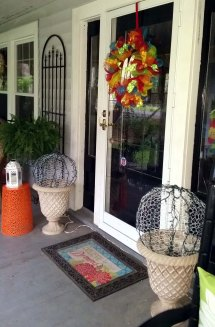 After - front door/sidelights painted black.